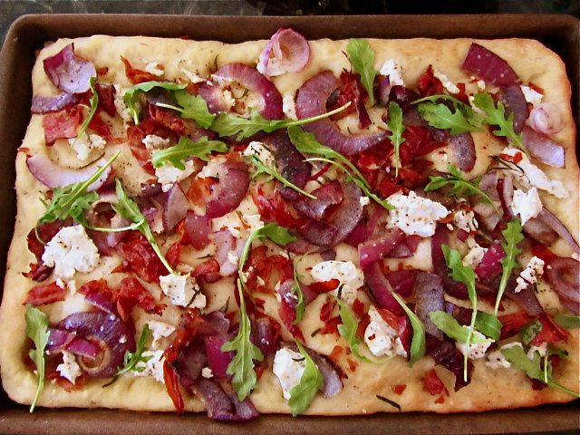 Crumbled Speck, goat cheese, red onion, rocket rosemary flatbread.