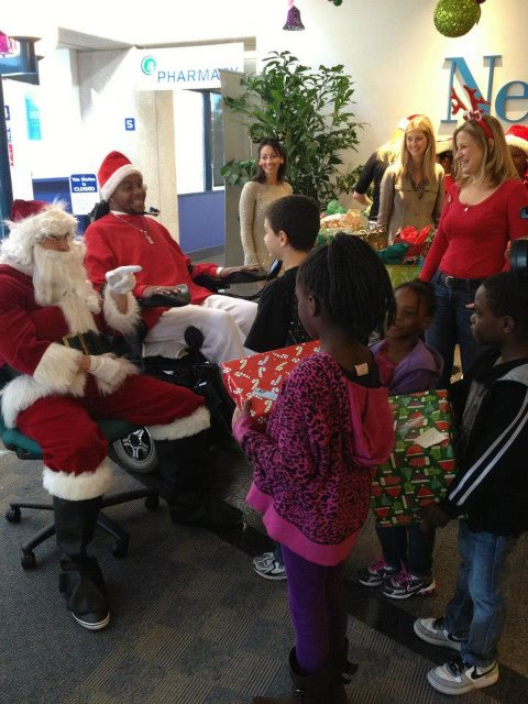 "J.T. and with ""Santa"" (First Coast Living's Nick Loren) makes smiles appear."