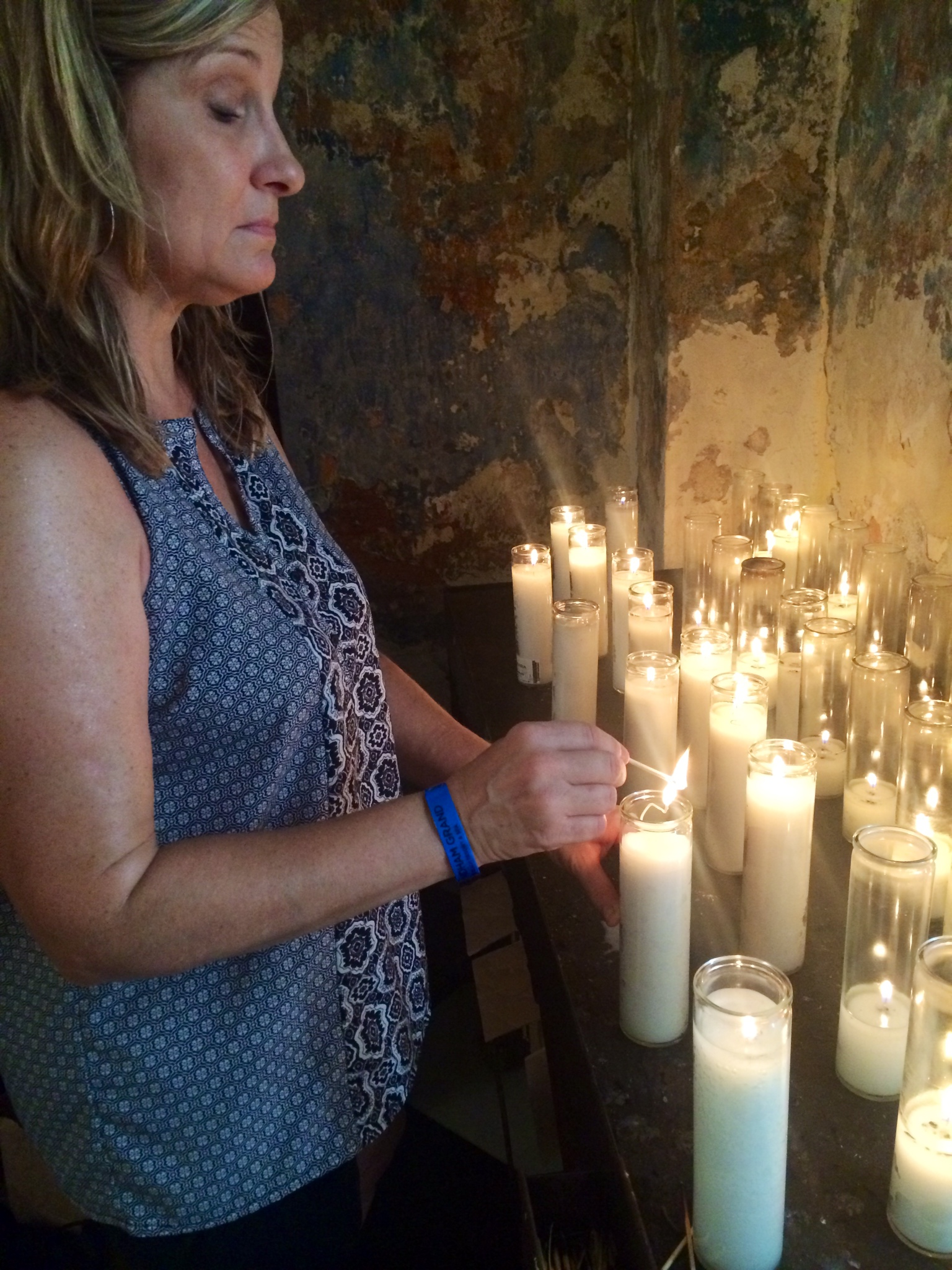 My sweet friend Kelly Winer lights a candle at beautiful Cathedral de San Juan